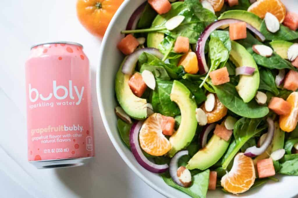 overhead view of can of grapefruit bubly next to avocado citrus salad