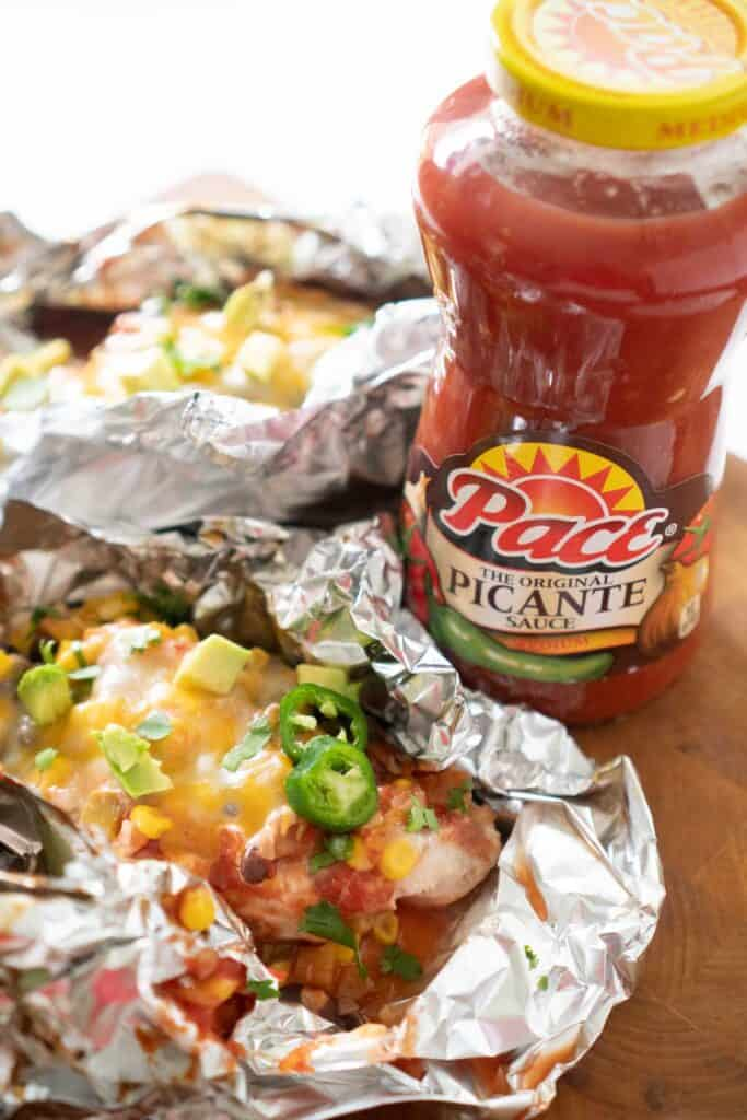 salsa chicken in foil with bottle of pace salsa