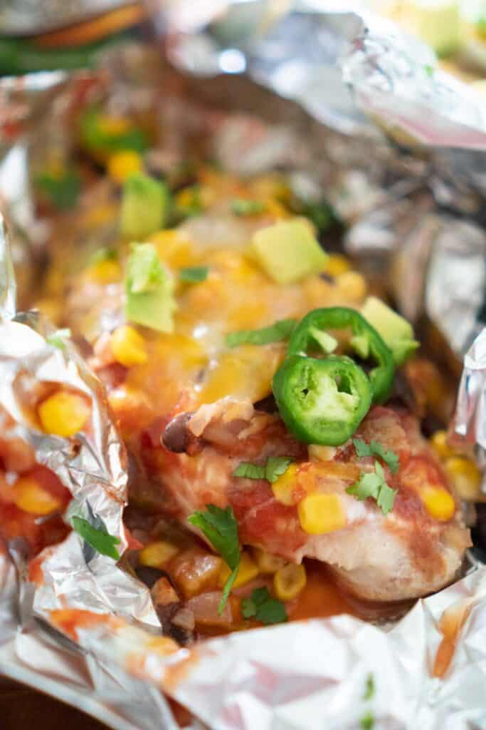 close up of salsa chicken in foil