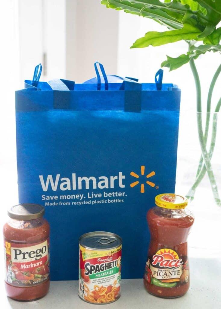reusable walmart shopping bag with sapghetti-os can, pace salsa, and prego marinara