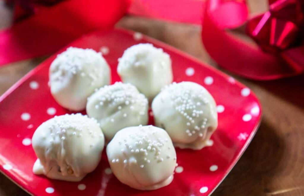 white chocolate truffles on red polka dot plate