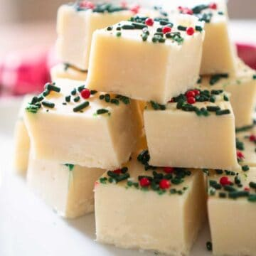 stack of white chocolate fudge with christmas sprinkles
