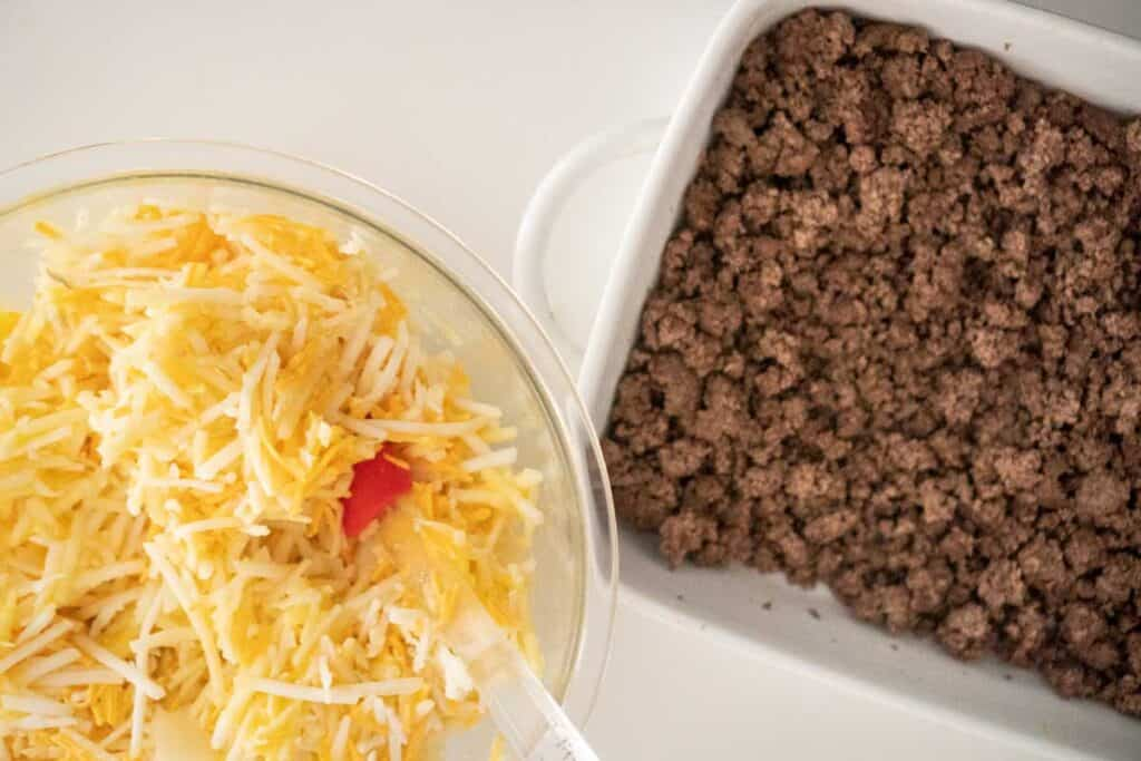 bowl of hash browns and baking dish of meat