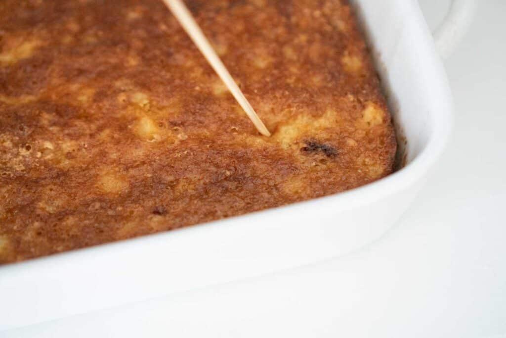 skewer poking holes in cake